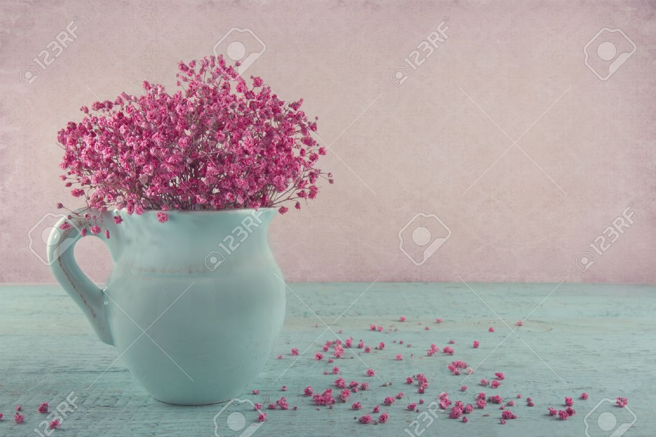 Pink Dried Baby S Breath Flowers In A Blue Jug On Wooden