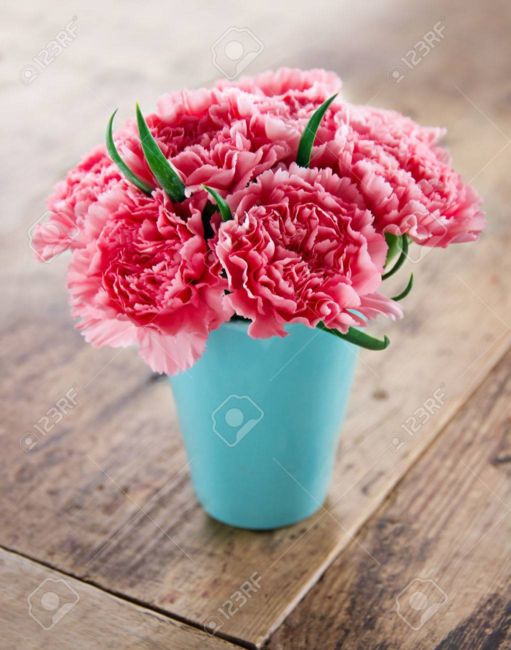 Pink Carnations Flower Bouquet In A Blue Vase On Rustic Wooden ...