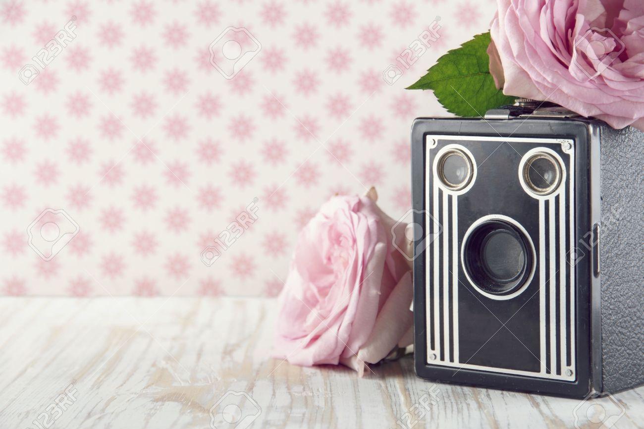 Old Classic Nostalgic Box Camera With Pink Roses On Vintage Shabby ...