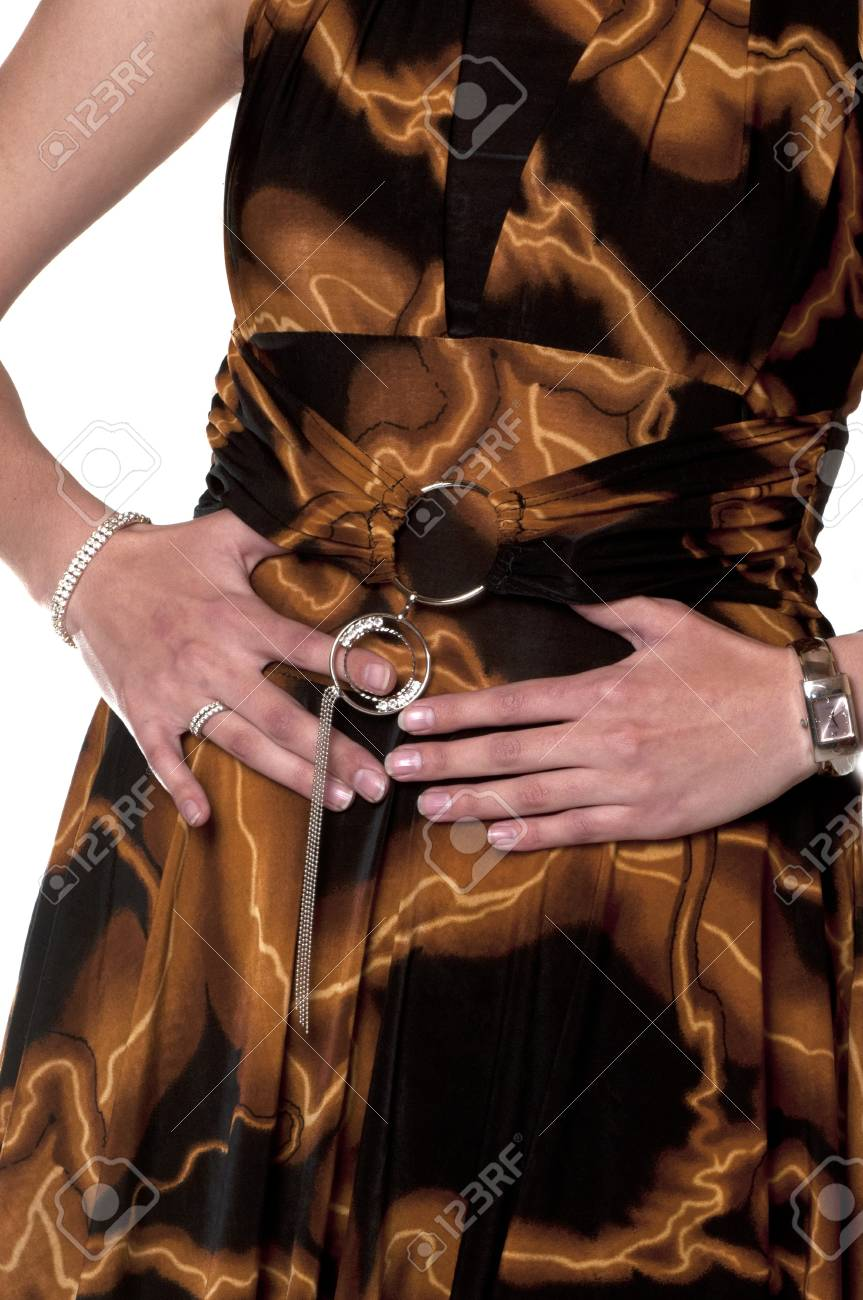 well dressed woman in brown holding her stomach with her hands Stock Photo - 7987490