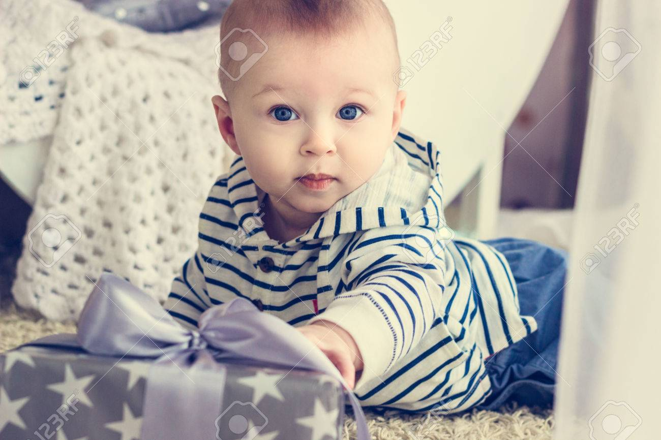 c2d37753b Portrait Of A Cute Baby Boy With Big Blue Eyes Wearing Jeans.. Stock ...