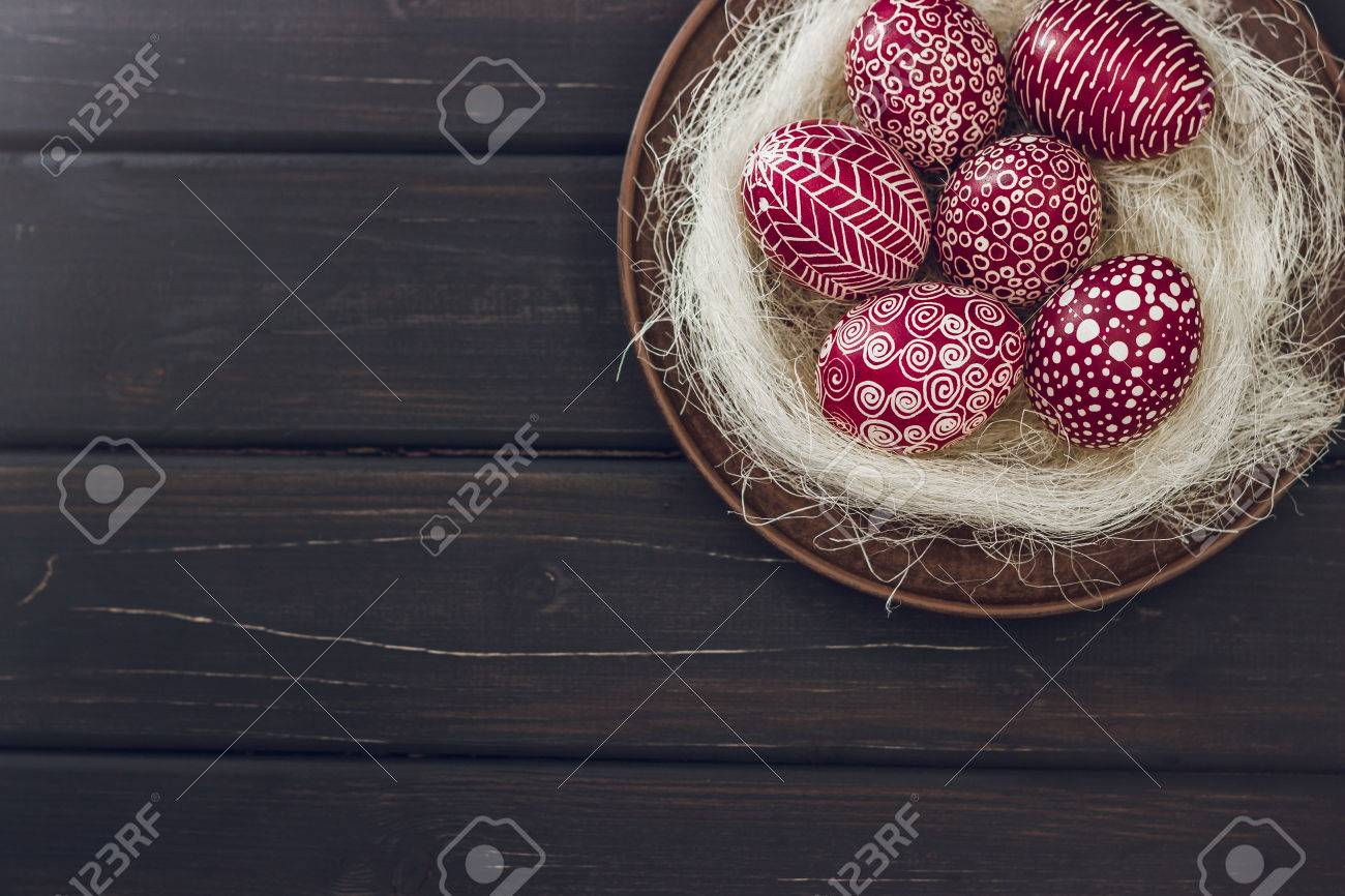 Still life with Pysanka, decorated Easter eggs, dry willow branches on black wooden background, top view, copy space Stock Photo - 73529858
