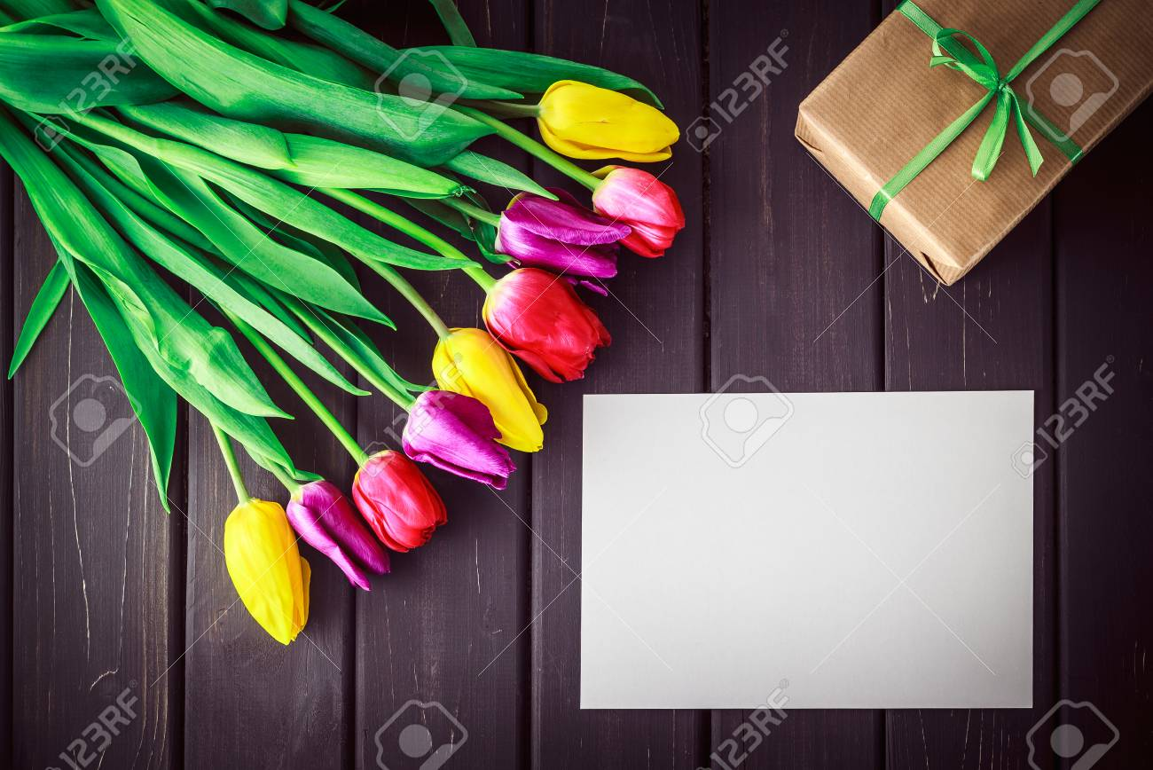 Bunch Of Purple Red And Yellow Tulip Flowers And Gift Box Wrapped