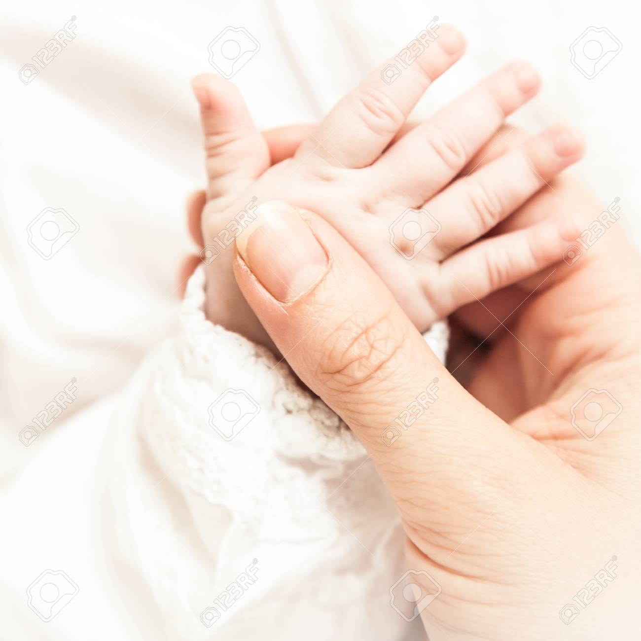 A Close-up of a baby hand Stock Photo - 13940641
