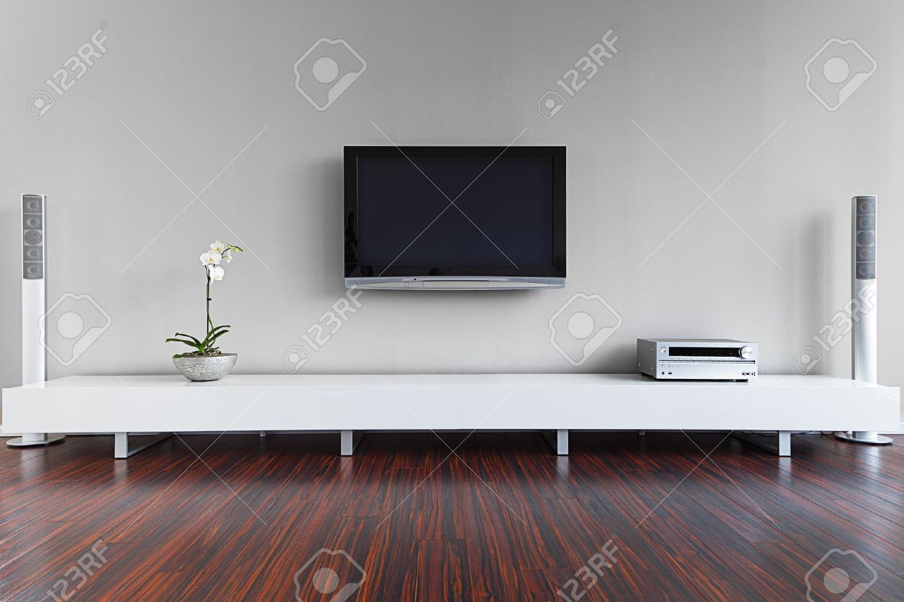 Modern Living Room With TV And Hifi Equipment Stock Photo