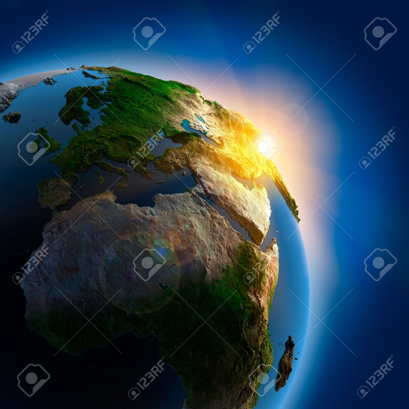 The sun's rays from the rising sun illuminate the earth in outer space Stock Photo - 7731542