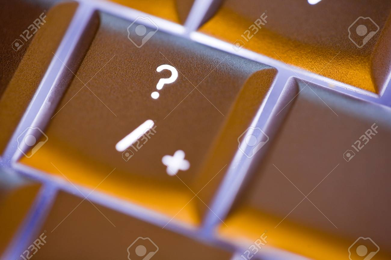 Close up of the question mark on an illuminated computer keyboard Stock Photo - 17980755