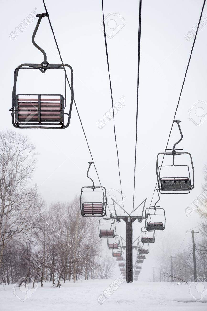 empty chair lift empty chair lift in the mist and snow at niseko ski resort