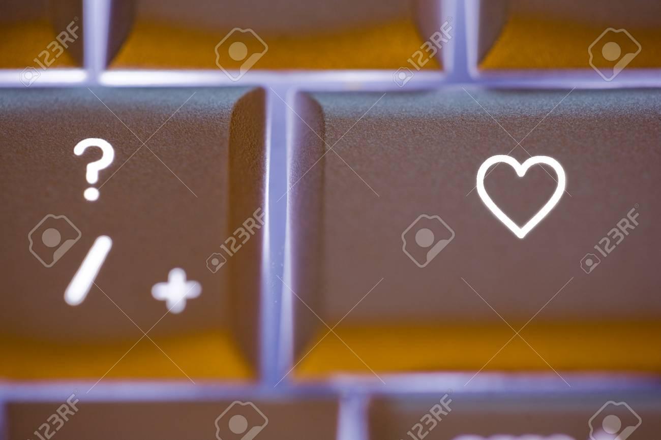 Close up of an illuminated computer keyboard with a heart shaped close up of an illuminated computer keyboard with a heart shaped symbol on the key buycottarizona Choice Image