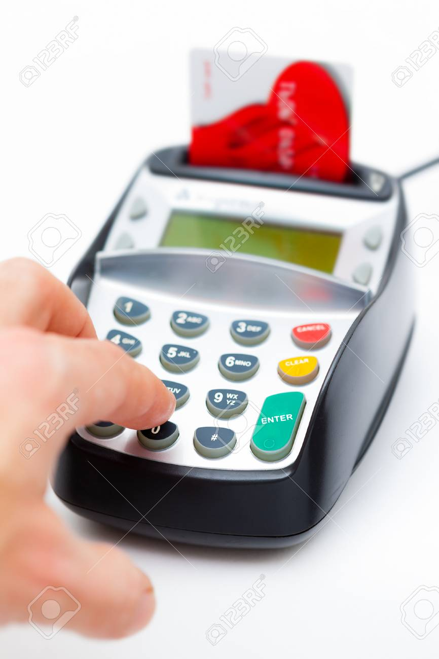 Close-up of a male hand entering a personal identification number on a chip and PIN machine Stock Photo - 25276529