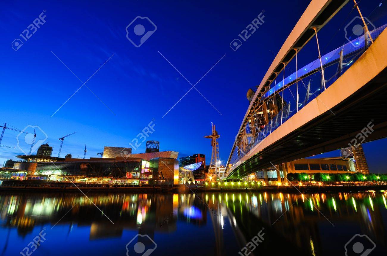 Dynamic architectural designed modern corporate buildings at night time with lights Stock Photo - 7319068
