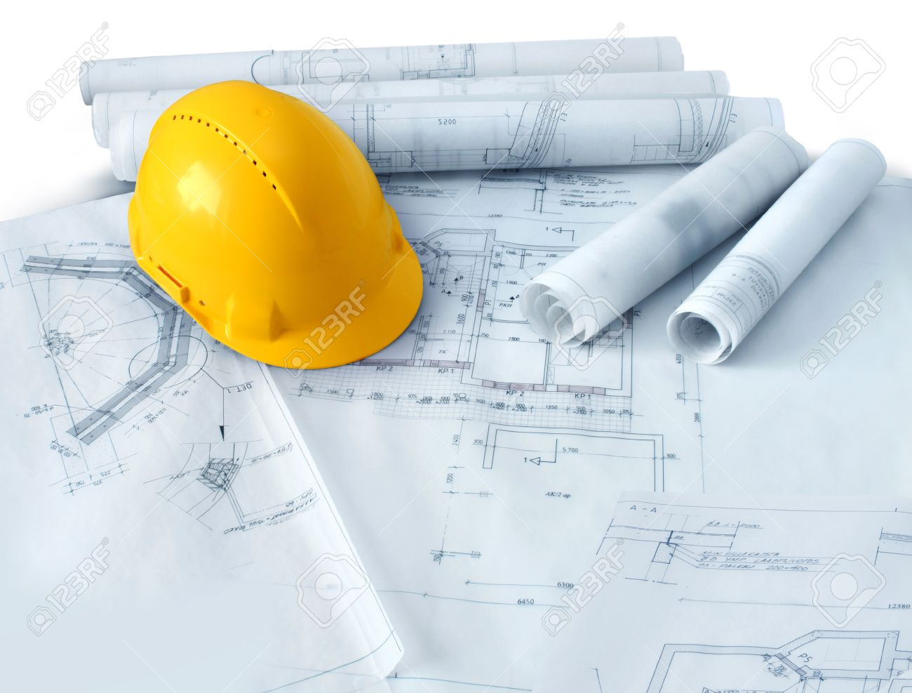 Construction Plans Drawings Rolls And Yellow Hard Hat Helmet Stock Photo