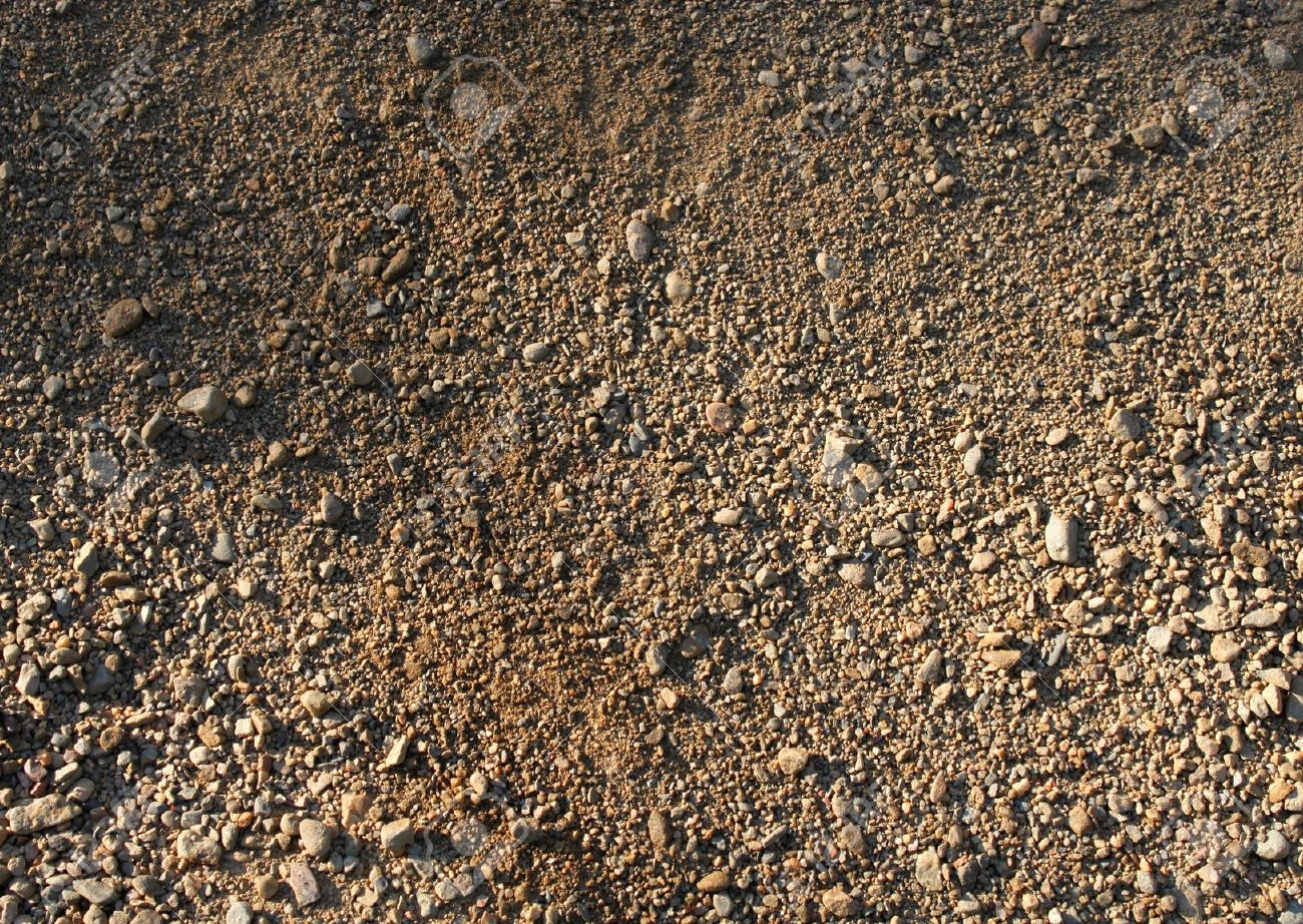 Natural brown rough sand gravel small stones background Stock Photo - 10413291