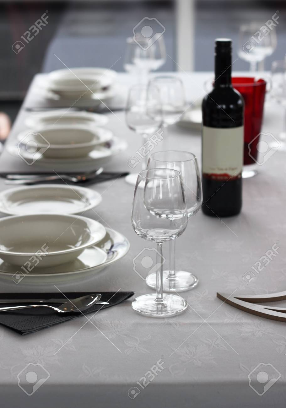 Casual Table Setting With Cutlery, Plates And Wine Glasses Stock Photo    14576658