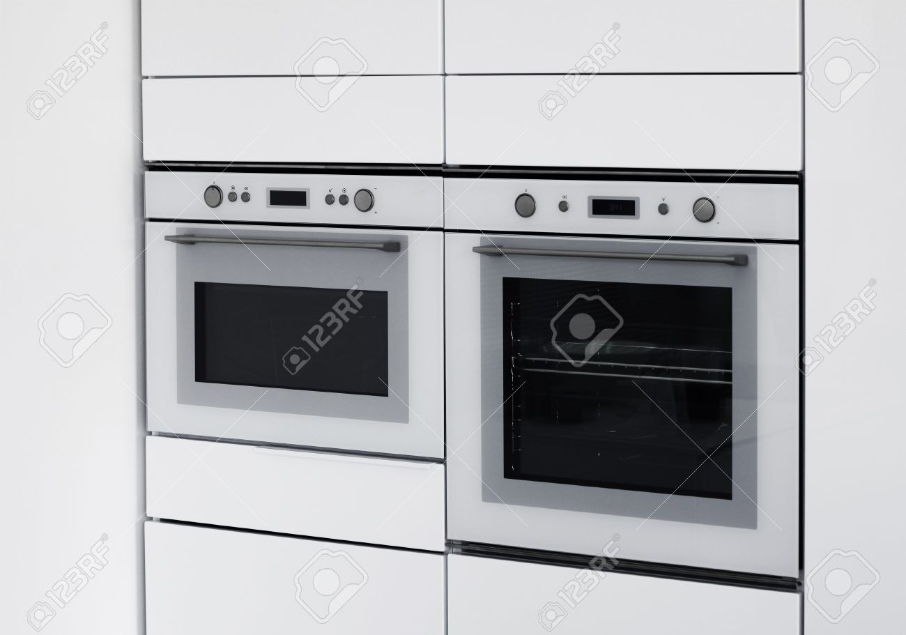 Modern Ovens Integrated In Contemporary White Kitchen Stock Photo ...