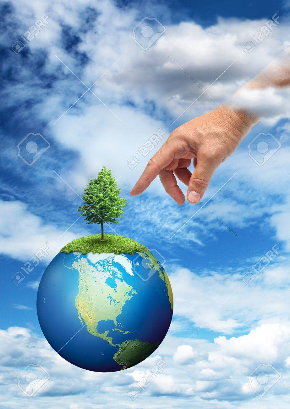 Male hand reaching to touch green tree on planet Earth Stock Photo - 14764842