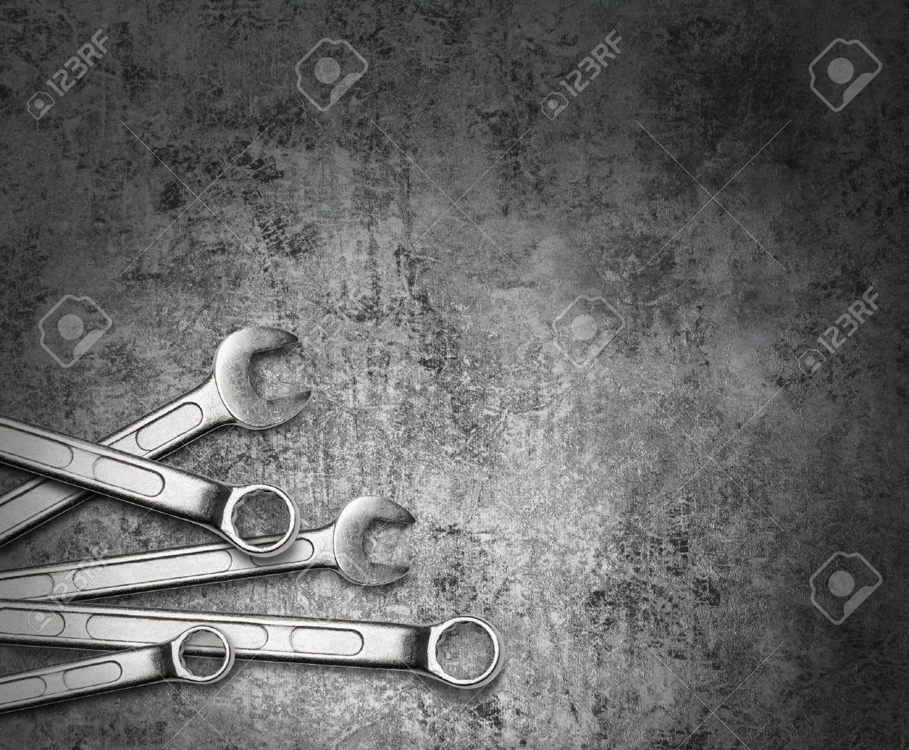 Wrench spanner tools on grunge silver metal background Stock Photo - 15016795
