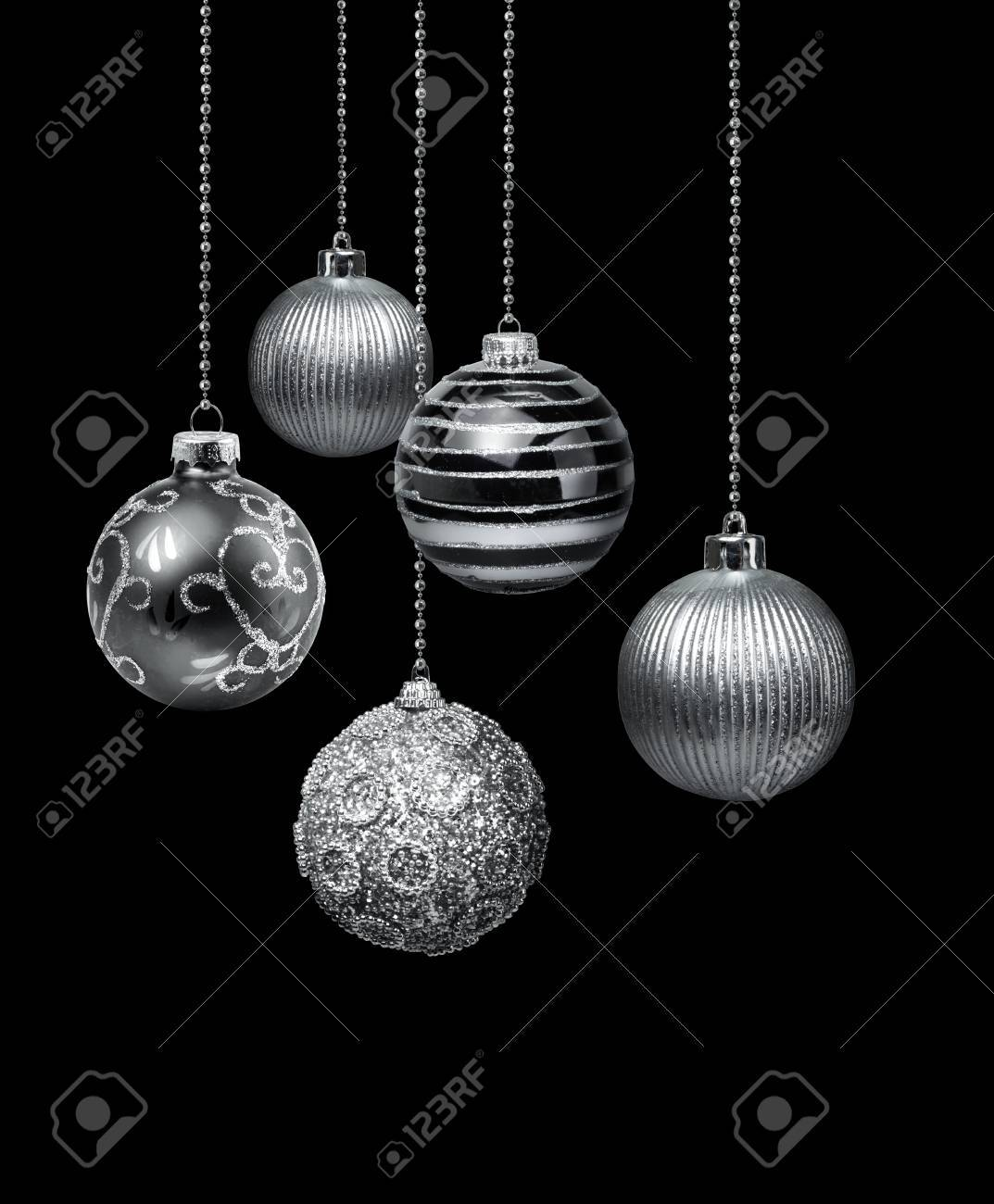 Five Silver Decoration Christmas Balls Hanging Black Background