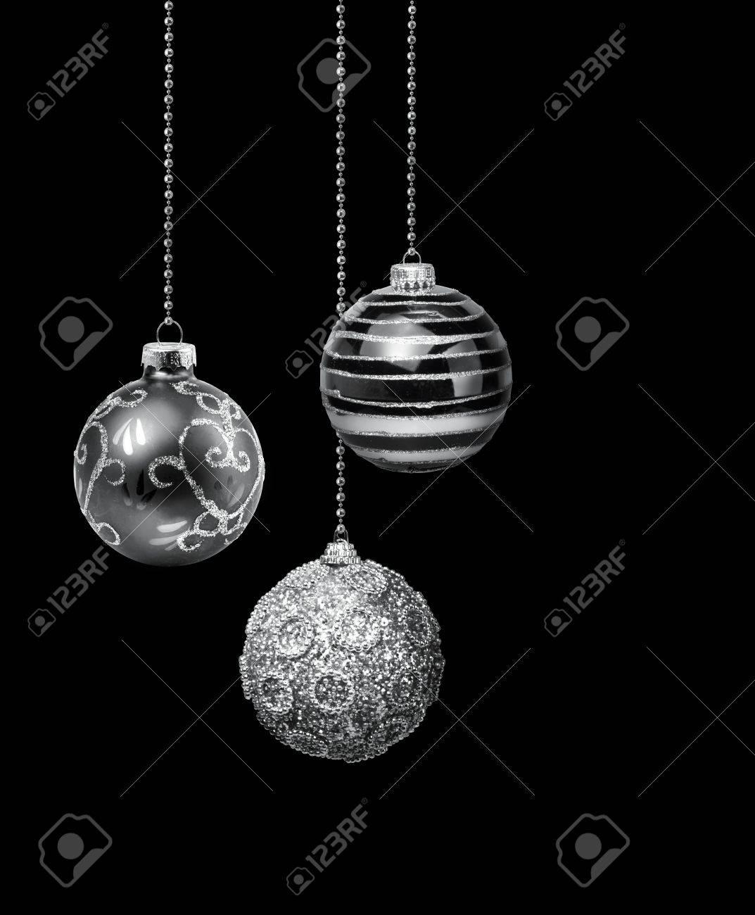 Three Silver Decoration Christmas Balls Hanging Black Background