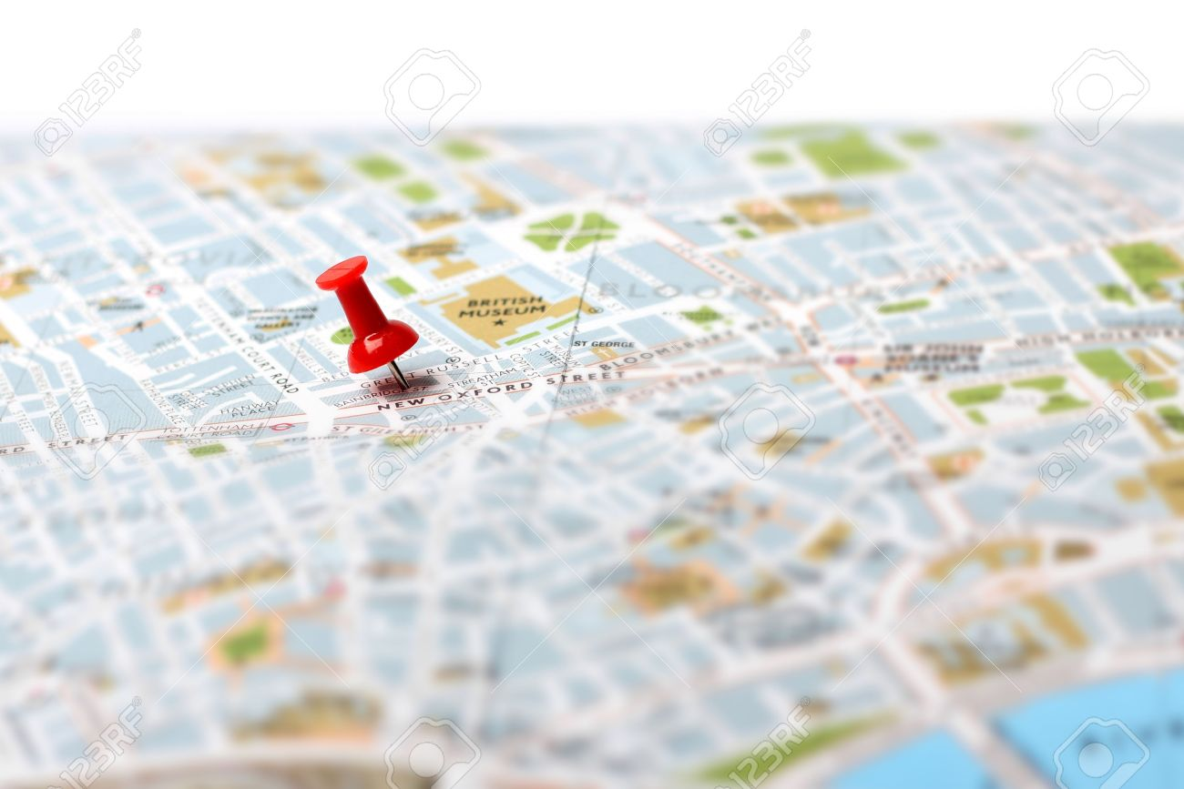 red push pin pointing planned travel destination on map stock photo 17470440