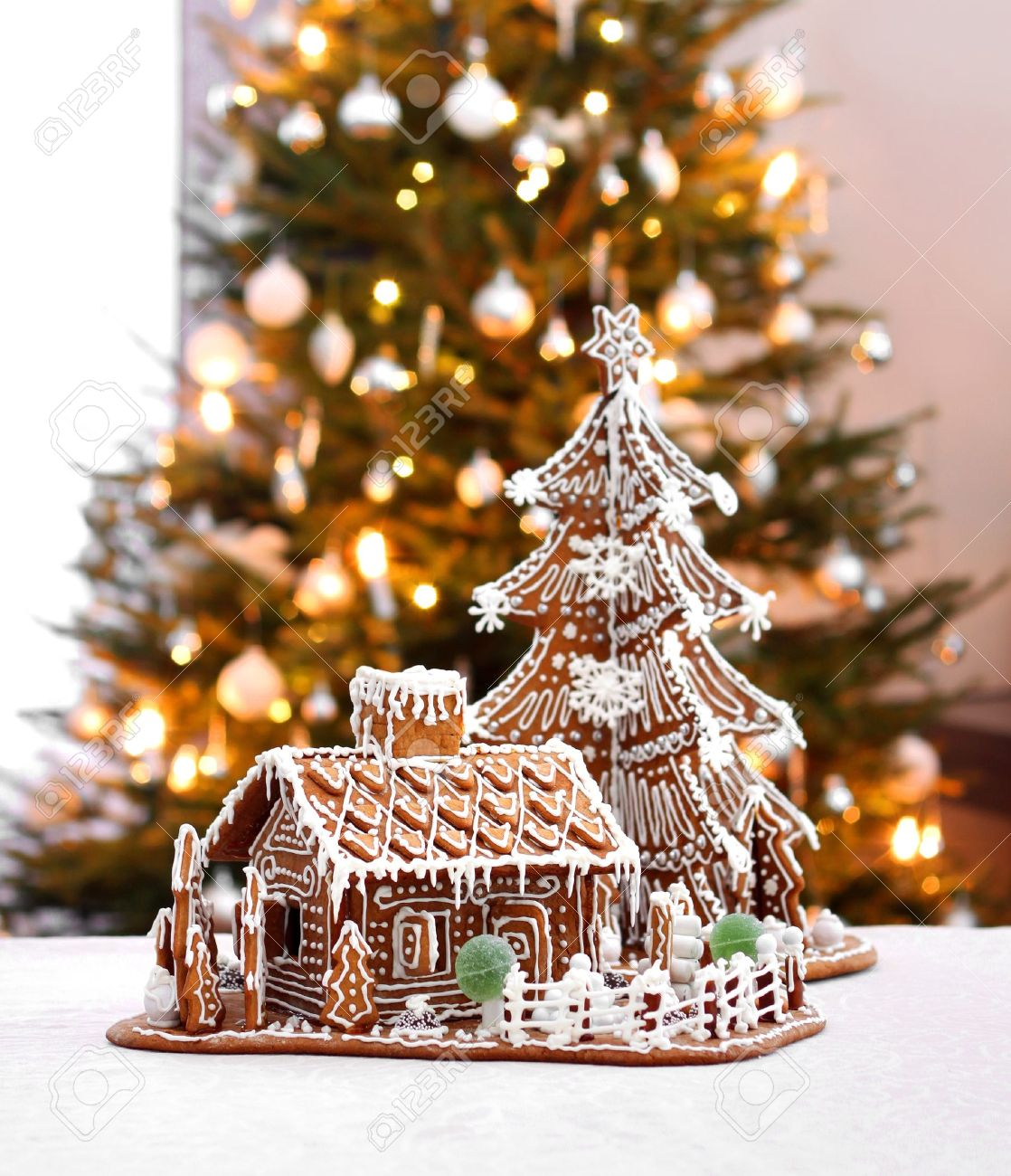 Gingerbread Christmas Tree.Gingerbread Cottage House And Christmas Tree Home Interior Background