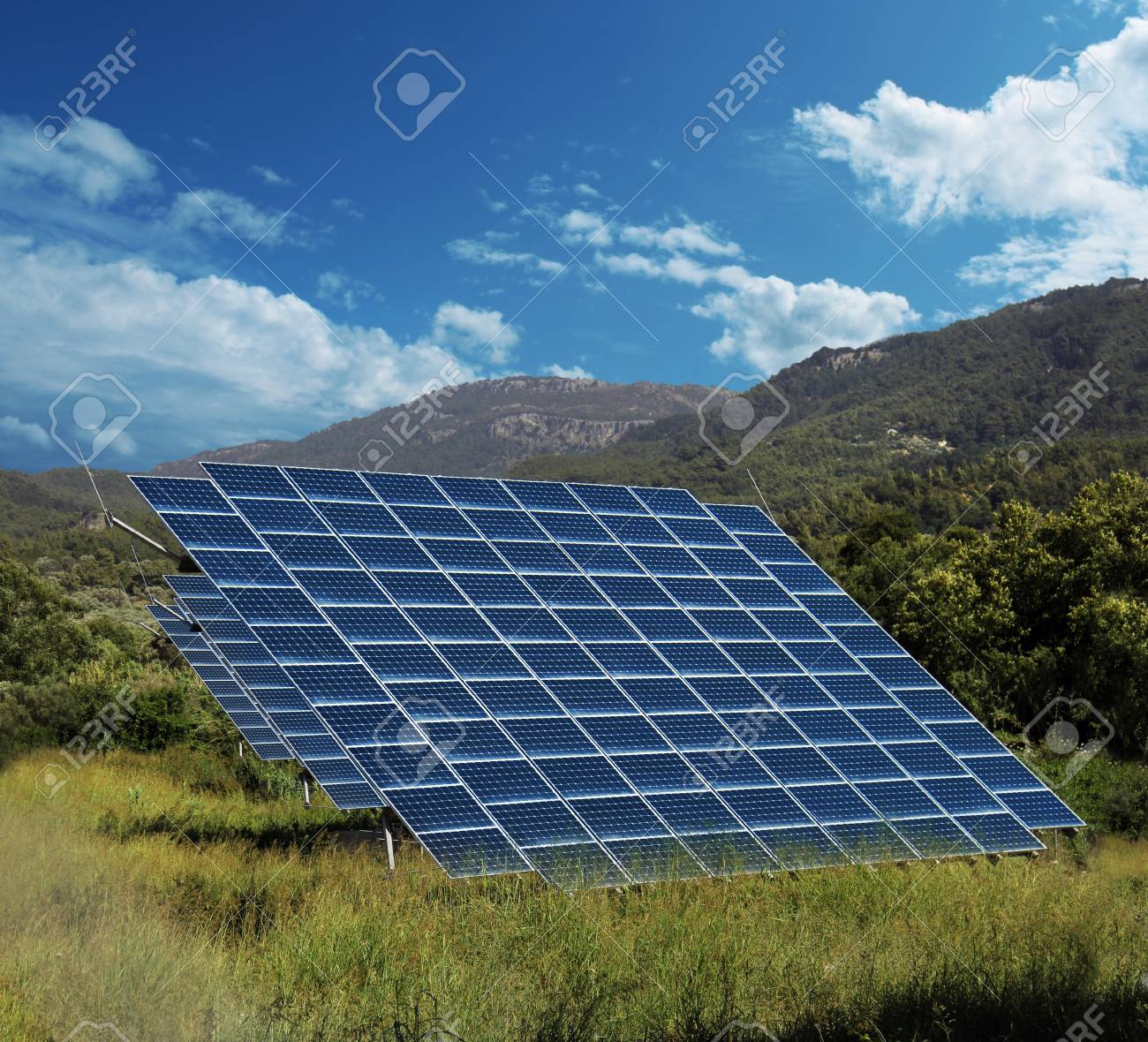 Solar energy panel collectors on sunny countryside landscape - 22224293