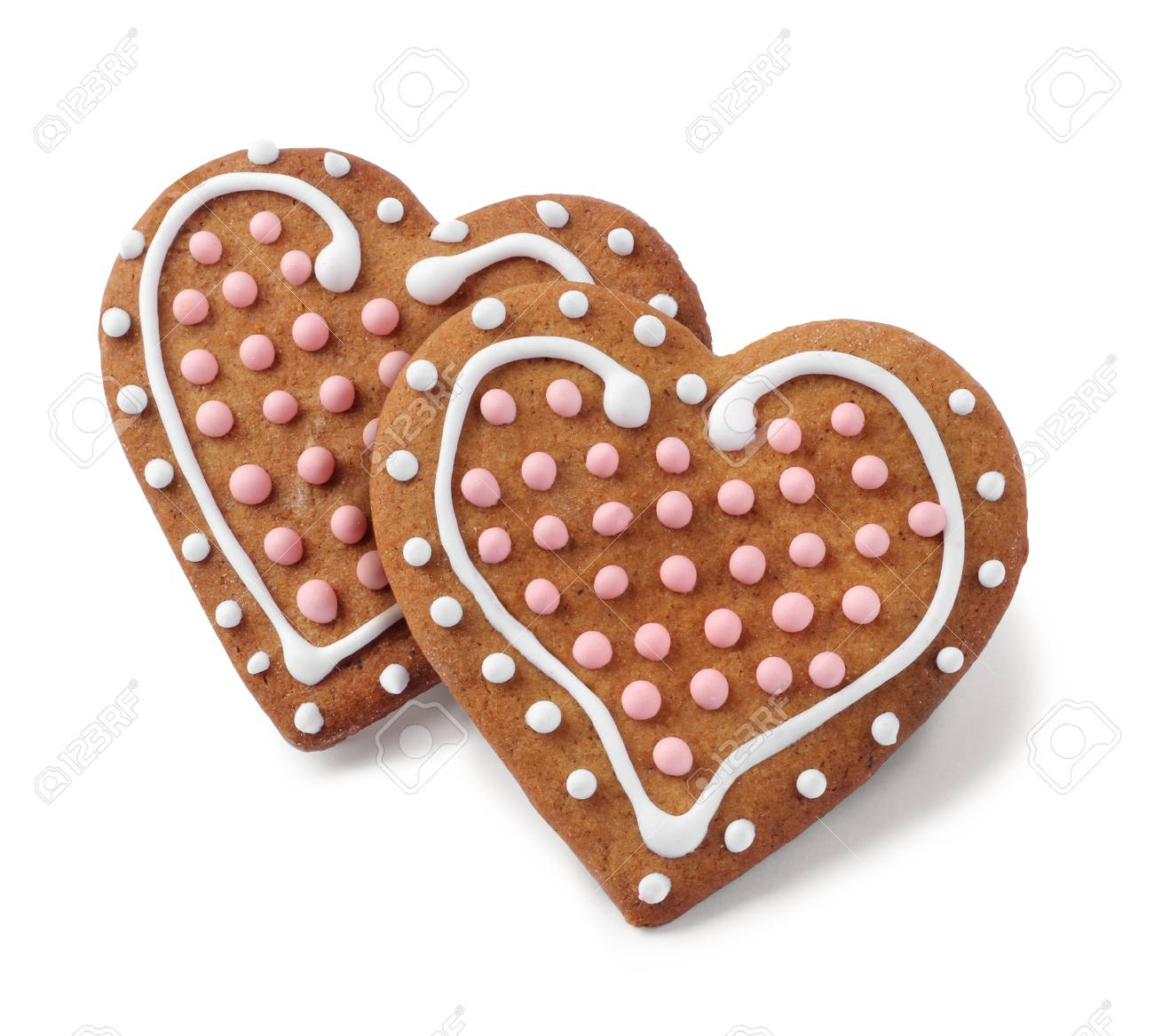 Two heart shaped Christmas gingerbreads isolated on white Stock Photo - 26072452