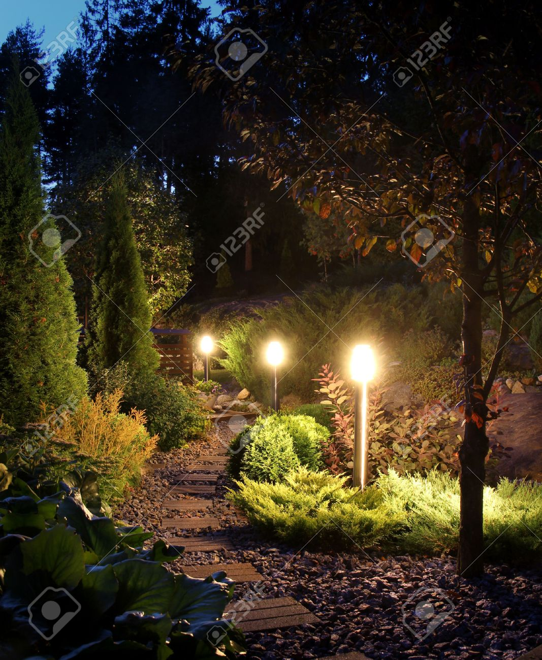 Illuminated Home Garden Path Patio Lights In Evening Dusk Stock