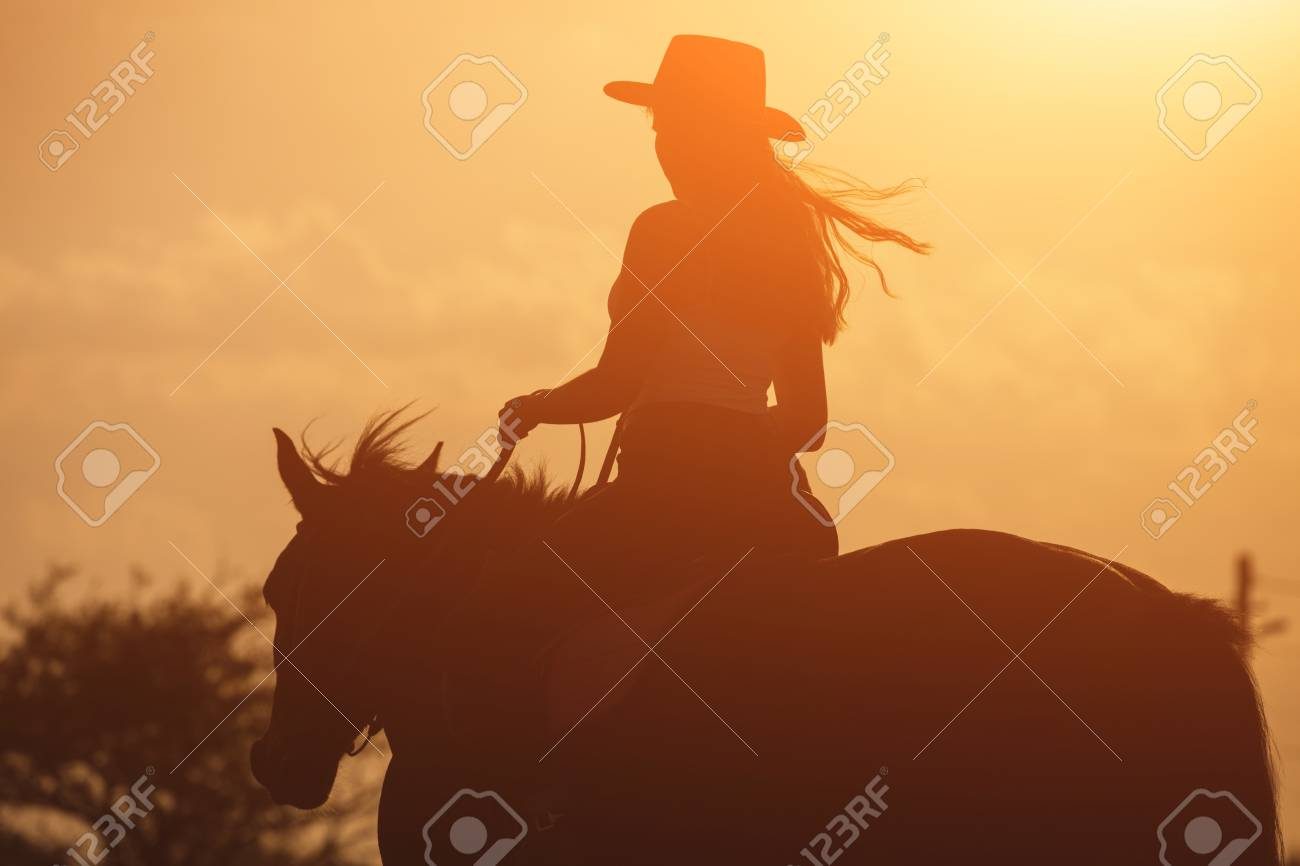 Sunset Golden Silhouette Of Young Cowgirl In Hat Riding Her Horse Stock Photo Picture And Royalty Free Image Image 86626700