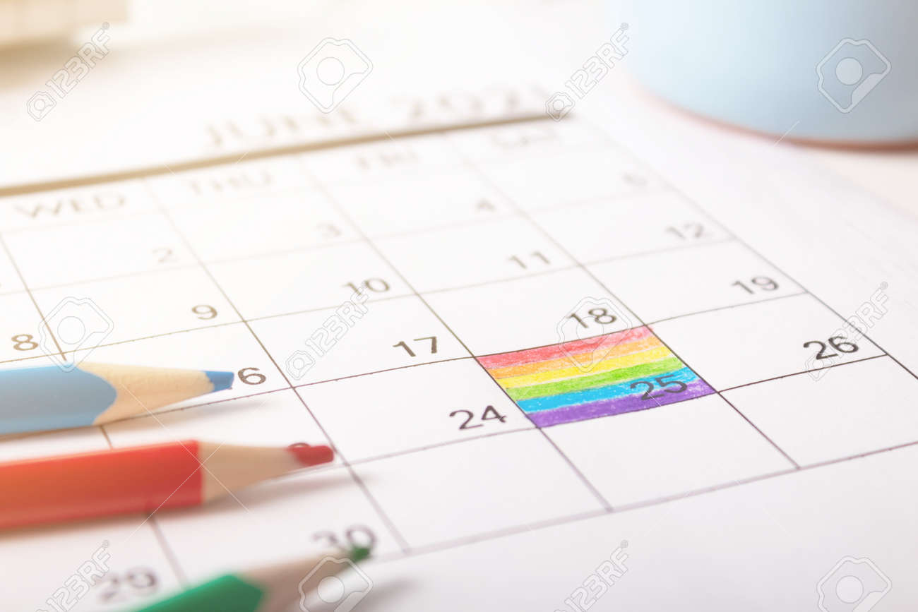 June 25, 2021 is rainbow flag day. painted in calendar the symbolic colors of the flag. - 169114582
