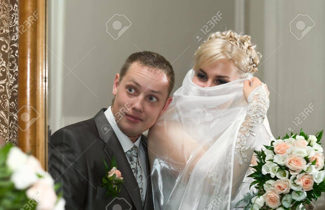 Loving wedding couple looking in mirror Stock Photo - 6106583