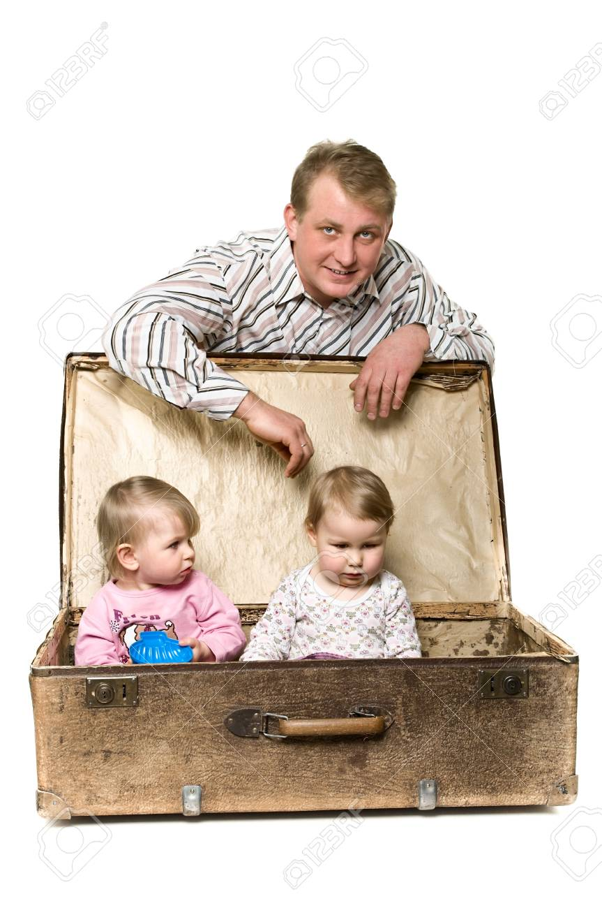 Yappy young father and two little children in ancient big suitcase. Isolated on white background Stock Photo - 6535675
