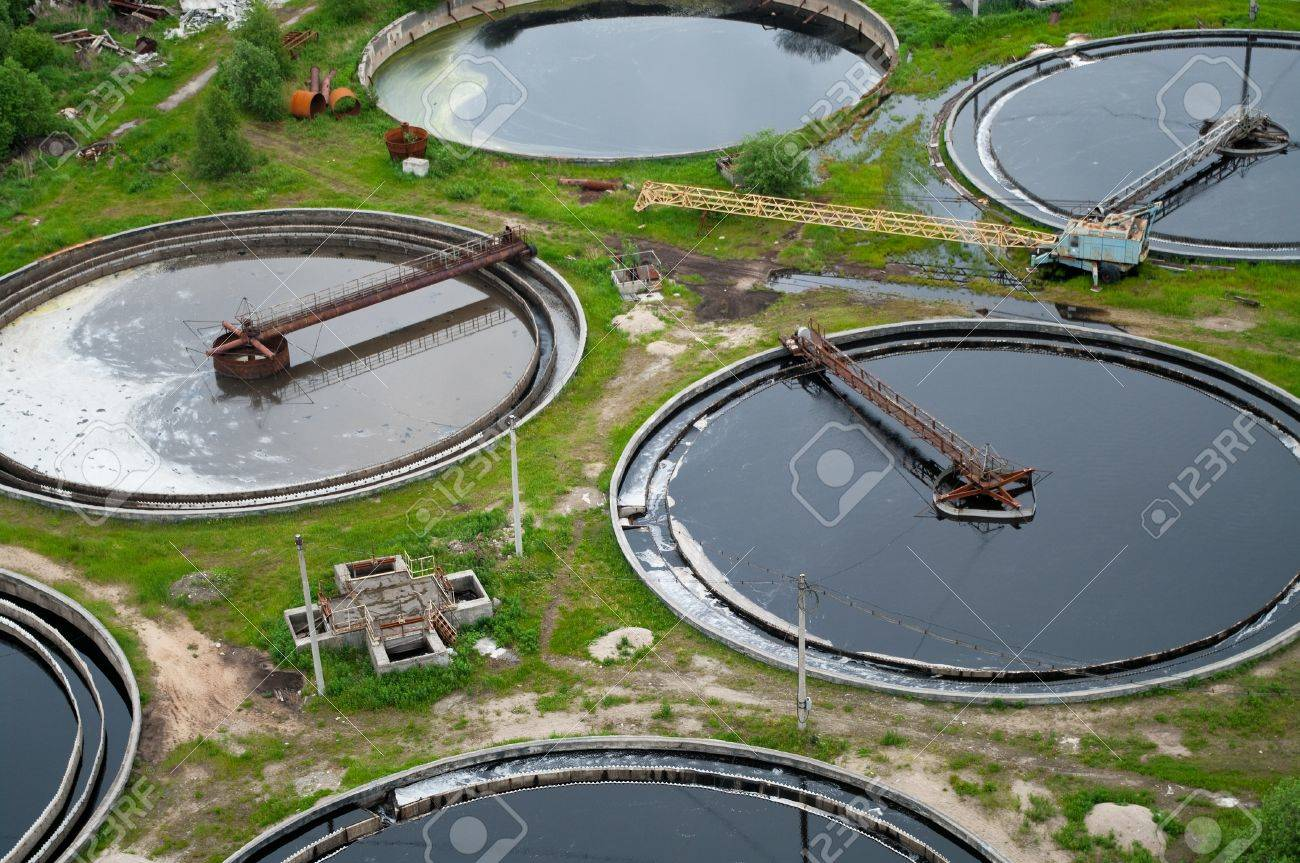 Group from the big sedimentation drainages. Water recycling, settling, purification in the tank by biological organisms on the water station. Stock Photo - 7682704