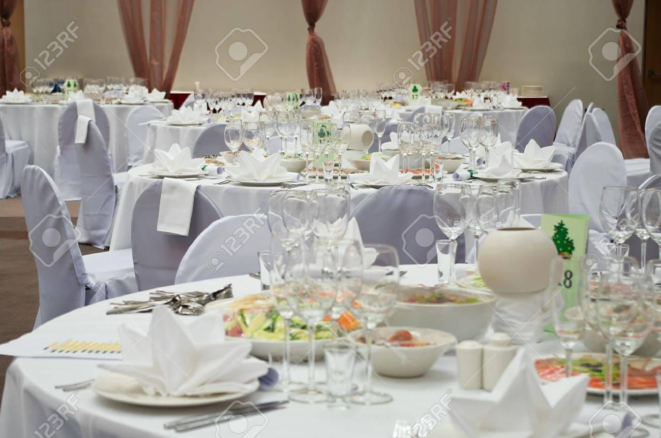 Wedding white reception place ready for guests. Elegant banquet tables prepared for a conference or a party. Stock Photo - 7682666