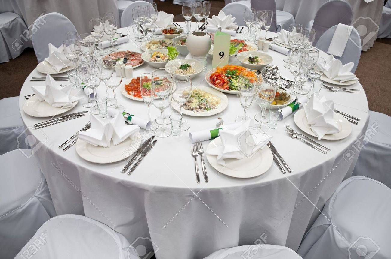 Wedding white reception place ready for guests. Elegant banquet tables prepared for a conference or a party. Stock Photo - 7682669