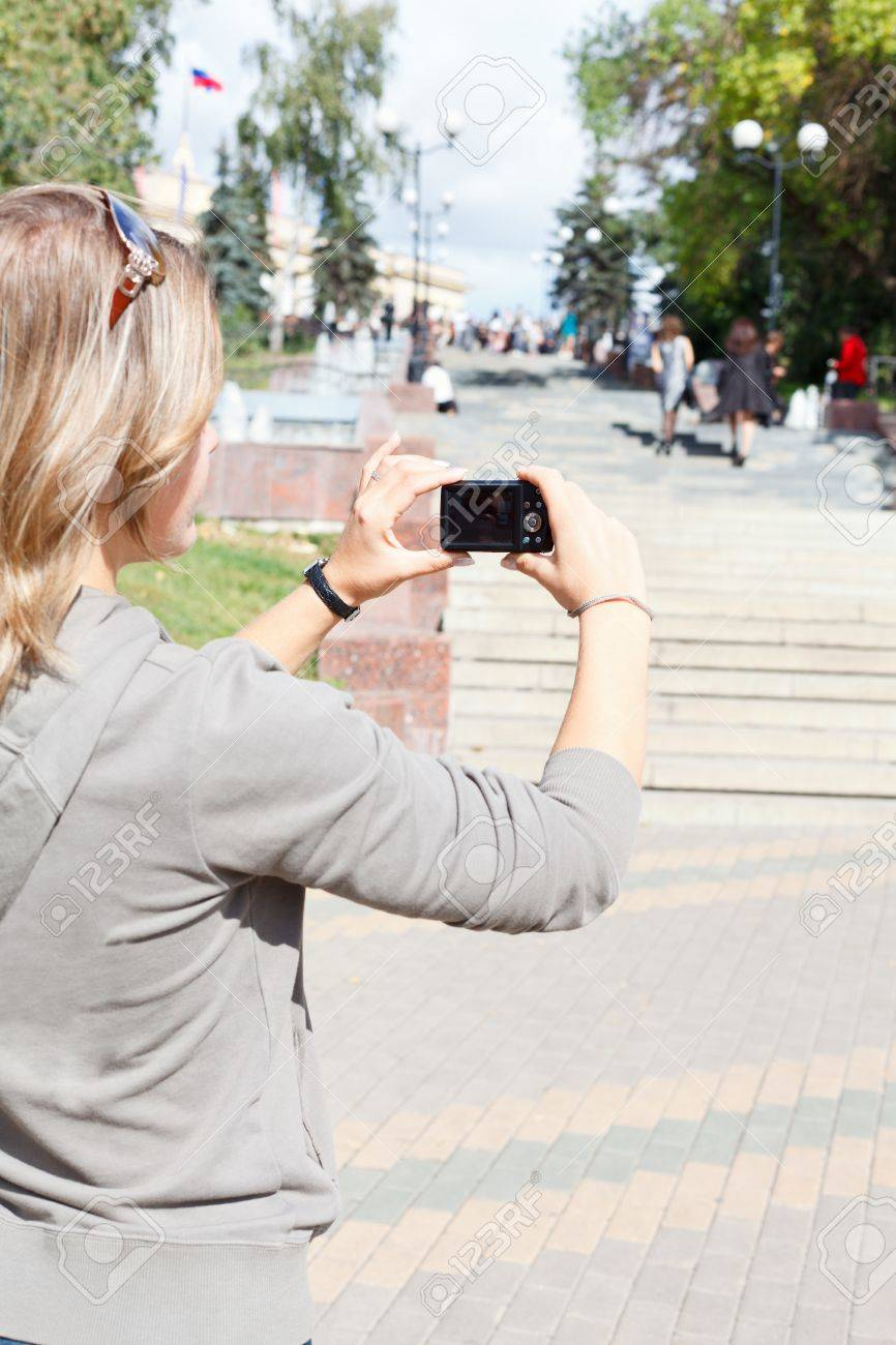 Young beautiful woman photographing city Stock Photo - 11056958