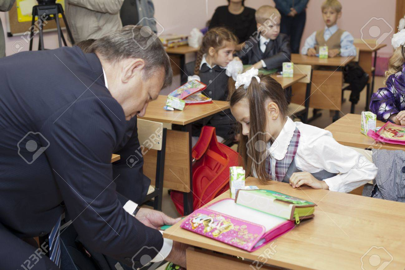 Saint-Petersburg, Russia-September, 1, 2011: Leningrad region Governor Valery Serdyukov in classroom during lesson in Russian school. Stock Photo - 11078963