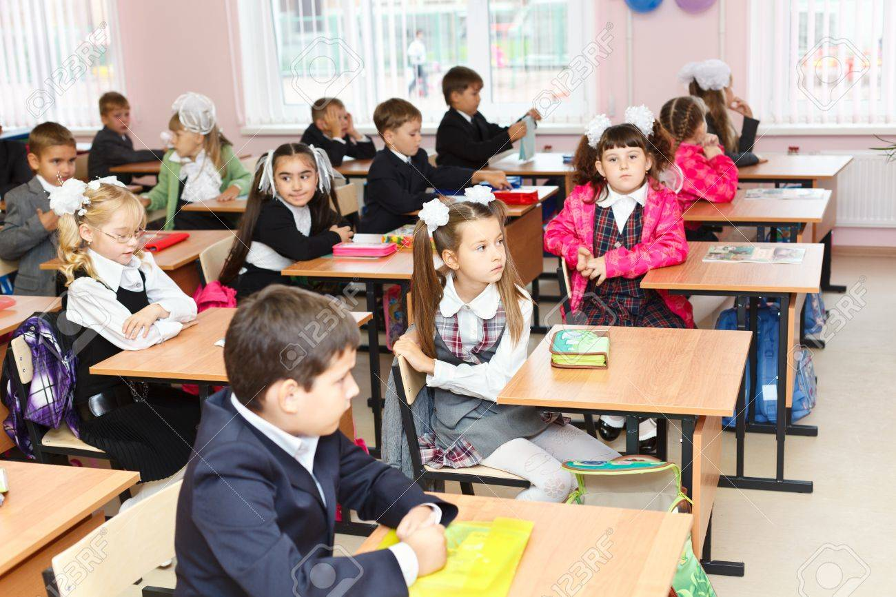 SAINT-PETERSBURG, RUSSIA: September 1, 2011: Russian boys and girls Caucasians students are sitting on the lesson in classroom in school at first September. Stock Photo - 11078971
