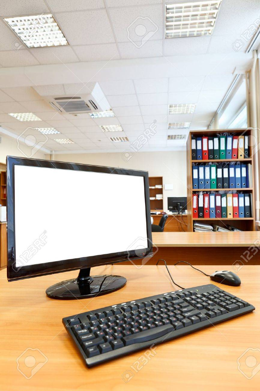 Modern personal computer on desktop in office room Stock Photo - 12435480