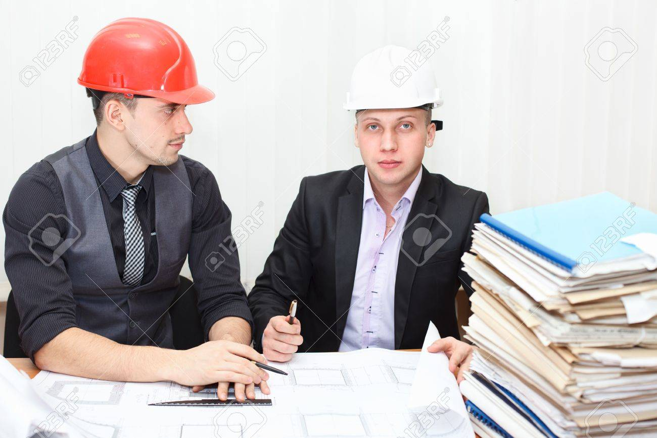 Architect and construction engineer discussing plan in office room Stock Photo - 12435483