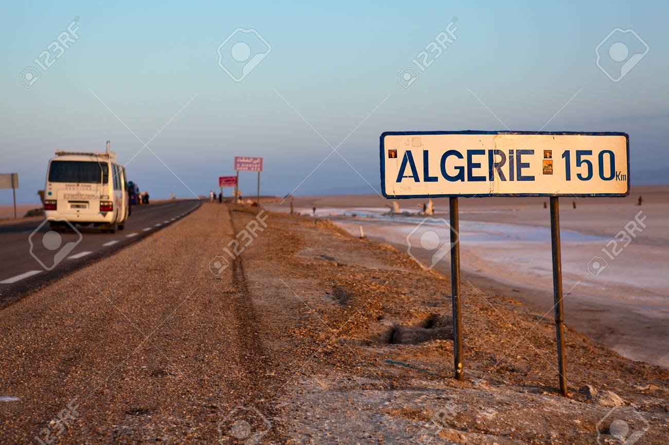 TUNISIA - CIRCA MAY 2012: Road through the salt lake Chott el Djerid  from the Tunisia to Algeria in the early morning on circa May 2012, Tunisia Stock Photo - 16285262