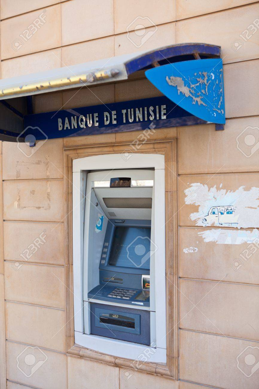 SOUSSE, TUNISIA - CIRCA MAY, 2012: ATM of National Bank of Tunisia in Sousse city in the wall, on circa May, 2012 in Sousse, Tunisia. Stock Photo - 14720322
