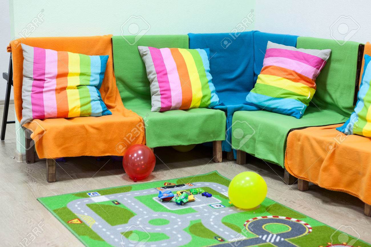 buy online f294b 18397 Corner sofa with colorful striped pillows, balloons on the floor..