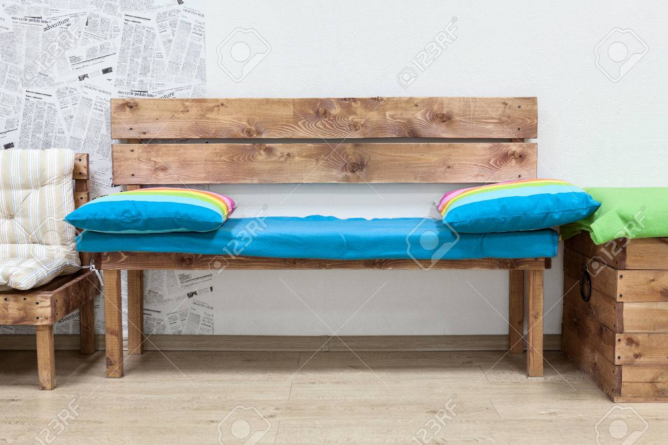 Wooden bench in the middle of ecological furniture Stock Photo - 40258241