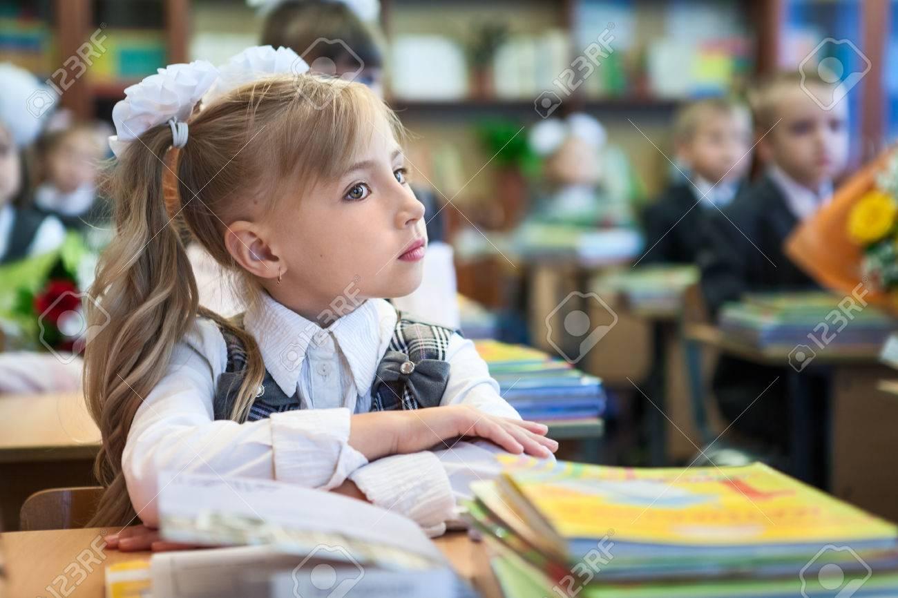 russian schoolgirl Schoolgirl with folded hands sitting at school desk at lesson, copyspace  Stock Photo - 41081245