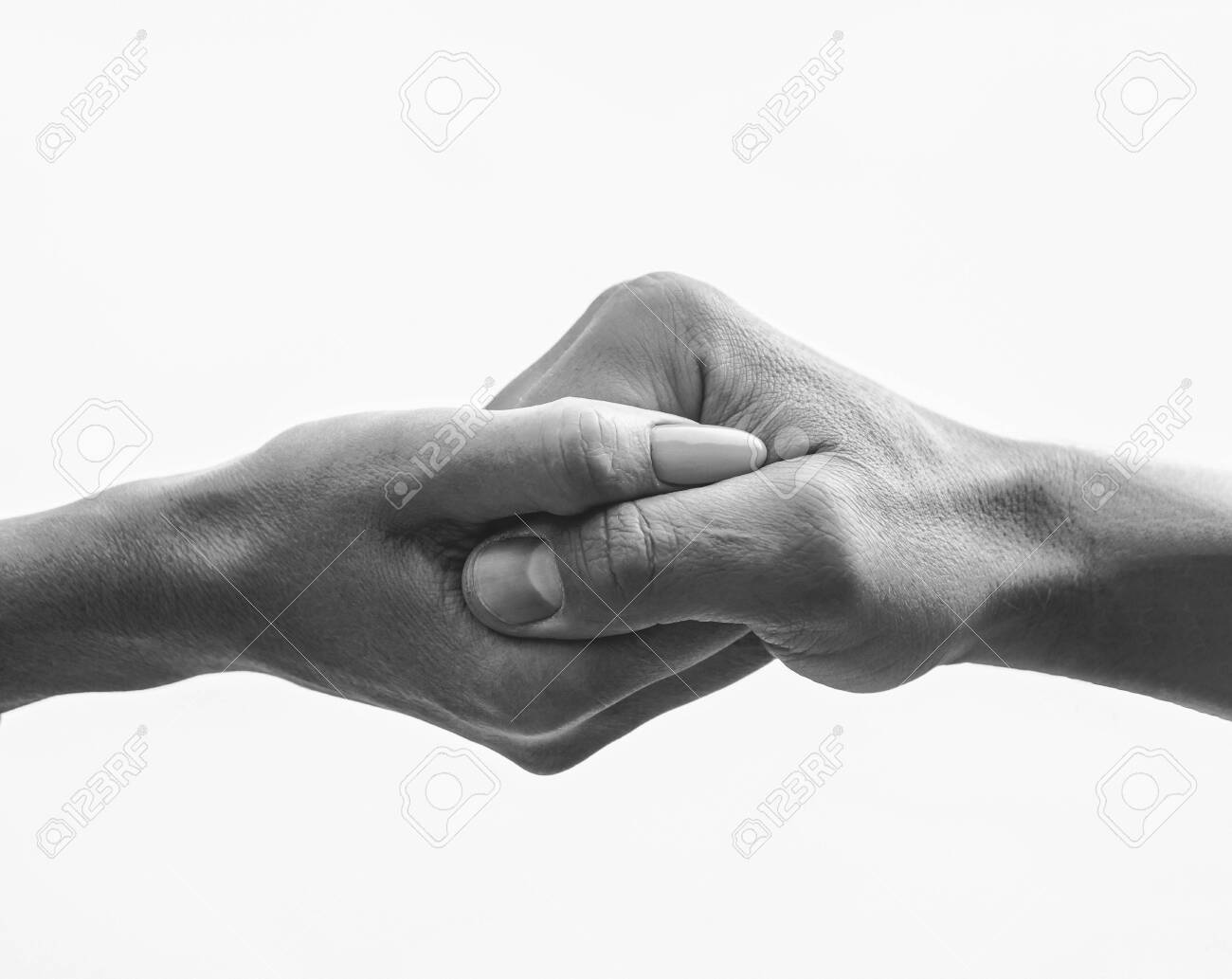 Female hand intertwined with a male hand - 151163677