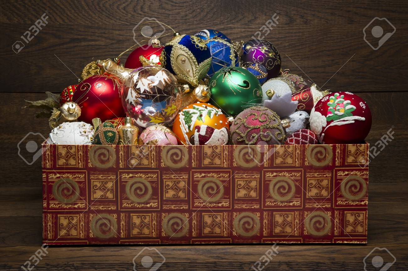 New Year Toys In A Box On A Wooden Background, Heap Of Christmas ...