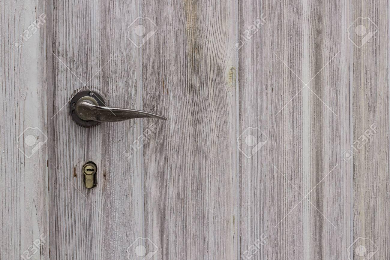 modern door texture. Modern Chrome Door Handle On A Wooden Texture Background Stock Photo - 35825611