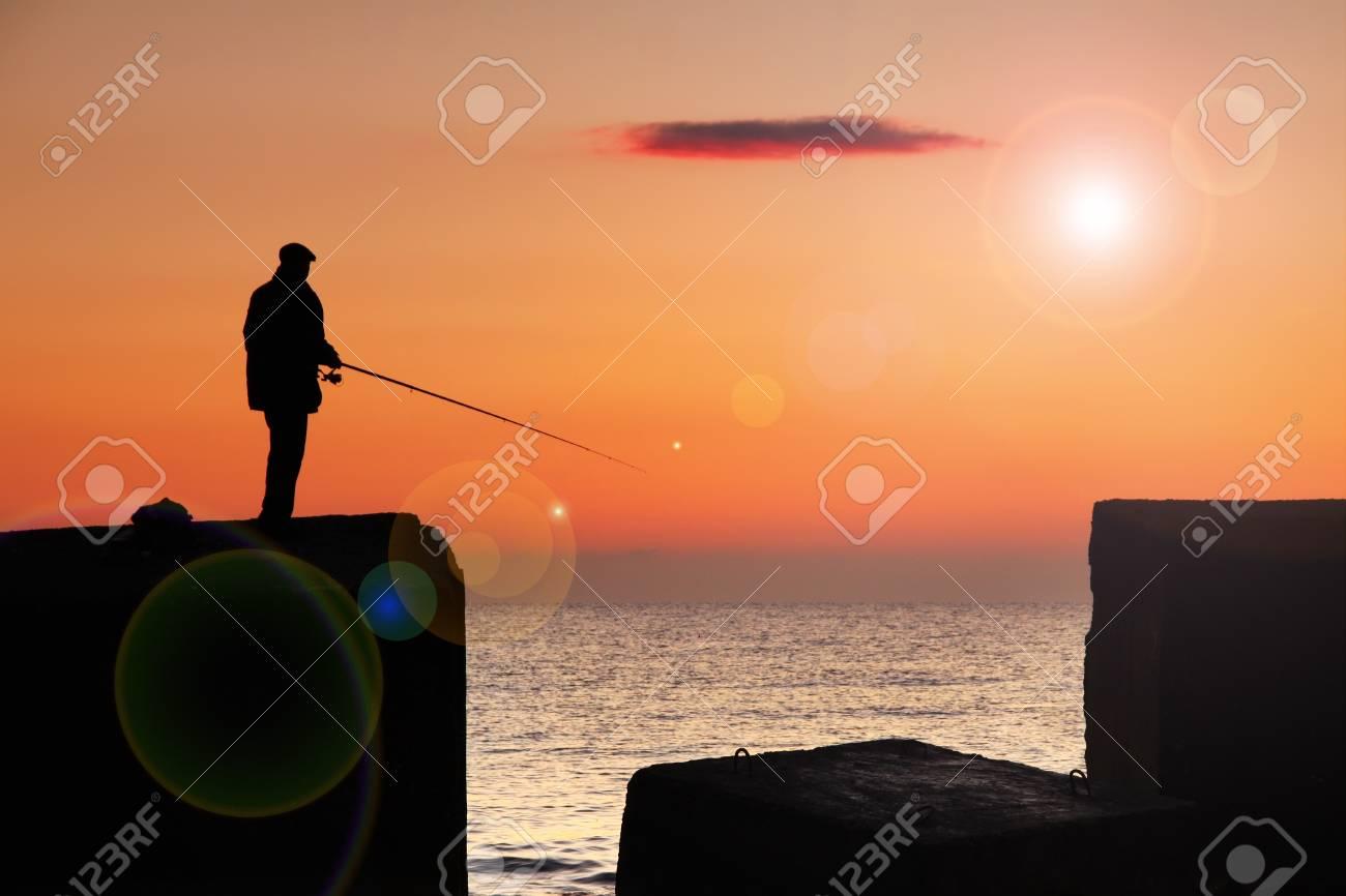 Fisherman at sunrise on the sea Stock Photo - 12082922