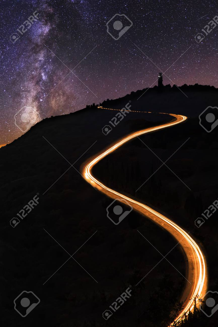 Starry Night And Milky Way Under The Road To Lighthouse